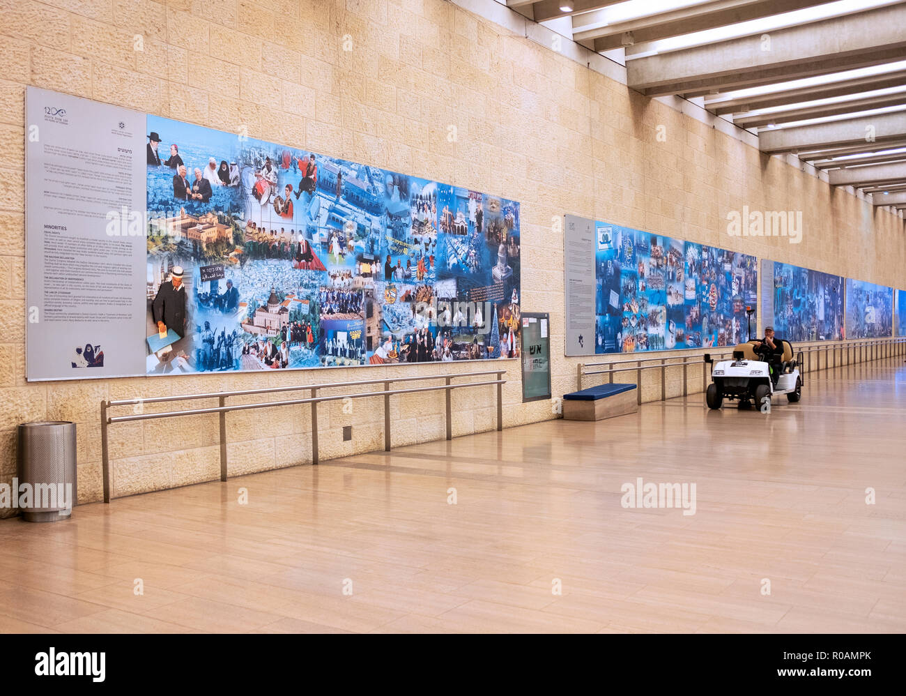A vehicle passes one of the '120 Years of Zionism' murals at Ben Gurion Airport in Tel Aviv, Israel. - Stock Image