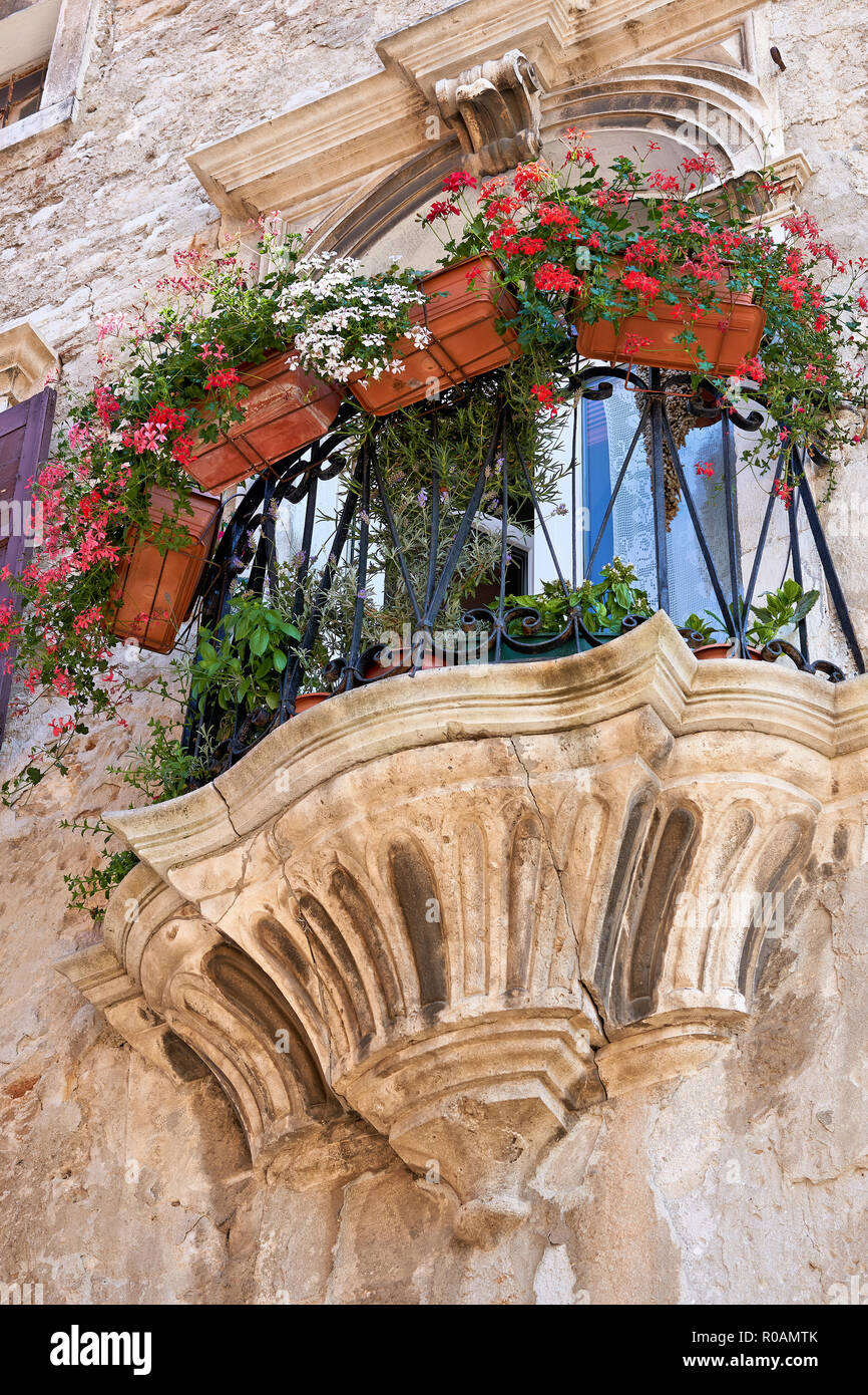 Balcony at a historic building in the old town of Pula in Istria in Croatia - Stock Image