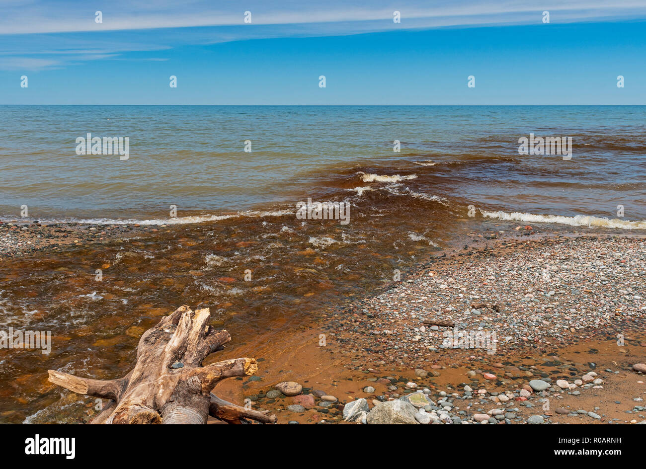 Tannin Filled Stream Water MIxing with the Blue Waters of Lake Superior at Pictured Rocks National Lakeshore in Michigan Stock Photo