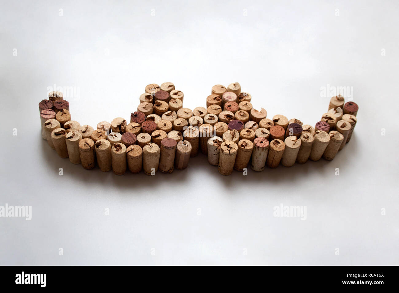 Wine corks mustache composition isolated on white background - Stock Image
