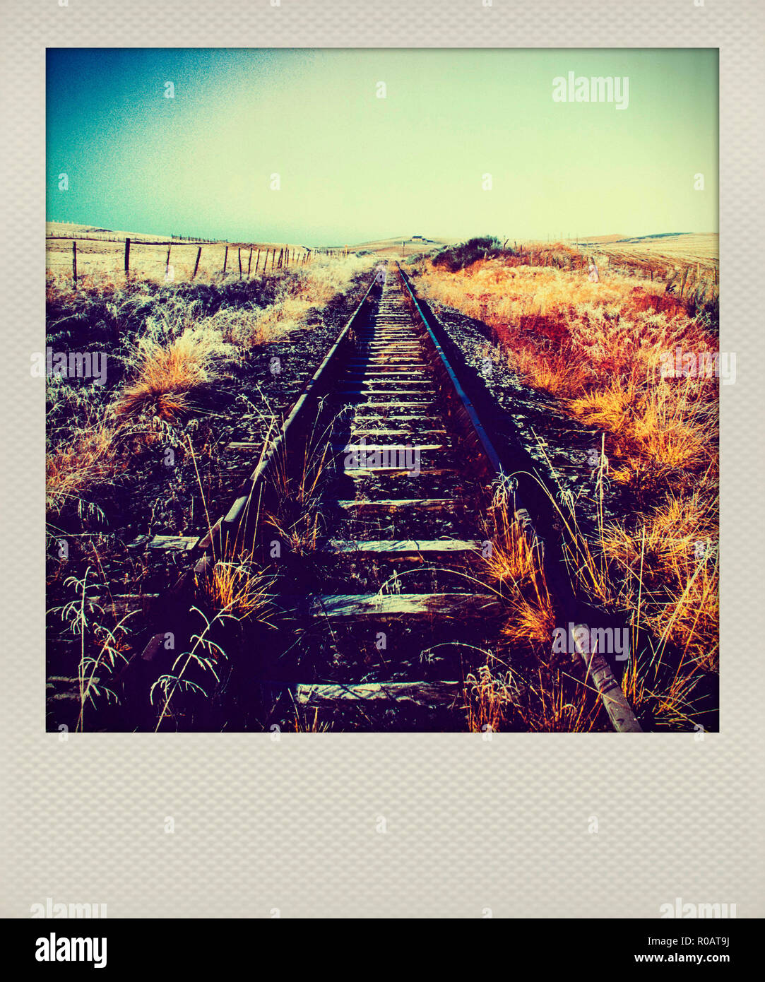 Polaroid of abandoned rail track in Auvergne, France - Stock Image