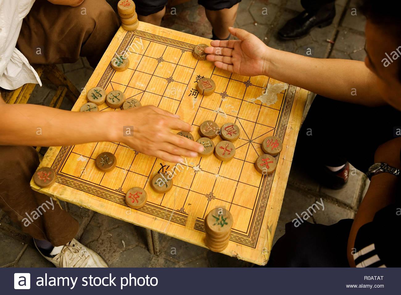 Men Playing Xiangqi in Park, Beijing, China - Stock Image