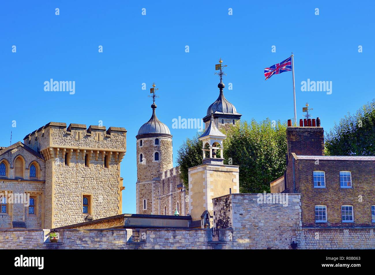 London, England, United Kingdom. White Tower within the Inner Ward of the Tower of London partially obscured by outer region structures. Stock Photo
