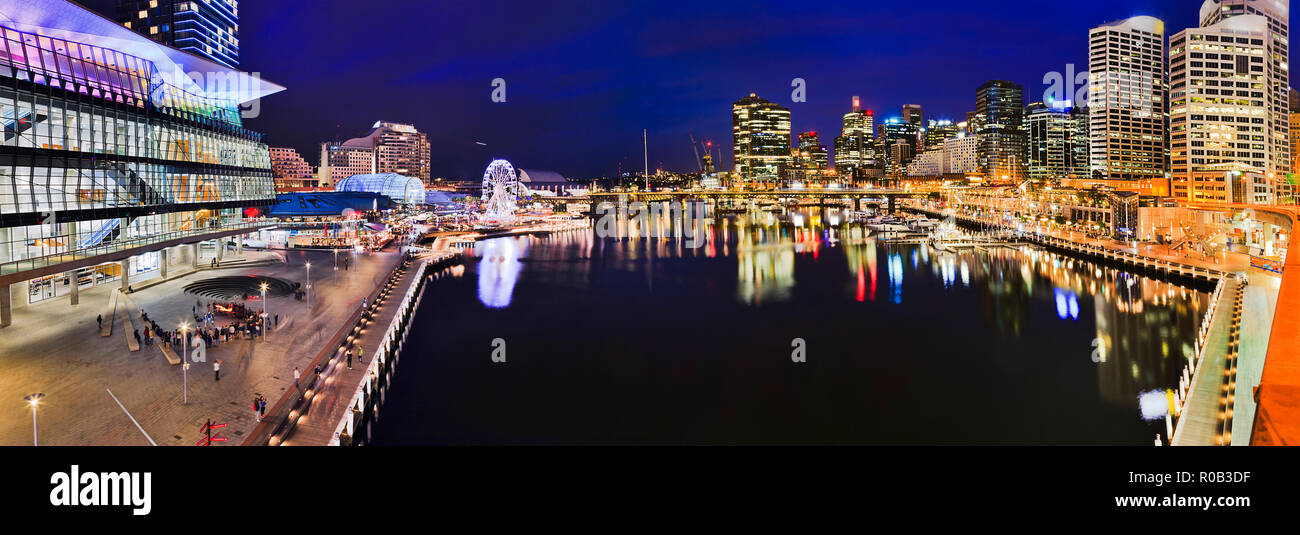 Dark blue panorama of Darling Harbour Cockle bay with surrounding high-rise buildings of urban architecture of modern city SYdney, Australia. - Stock Image
