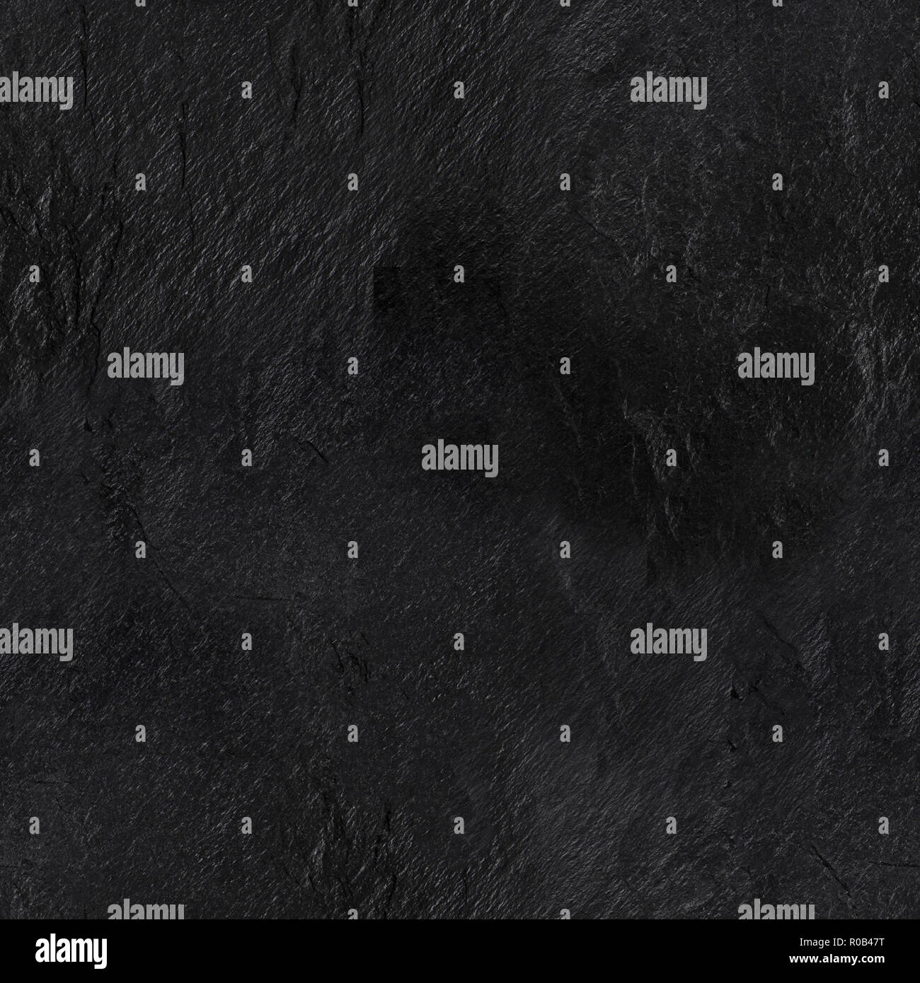 A seamless pattern of an abstract black slate background, a dark texture with a place for text, a stone repeat print - Stock Image
