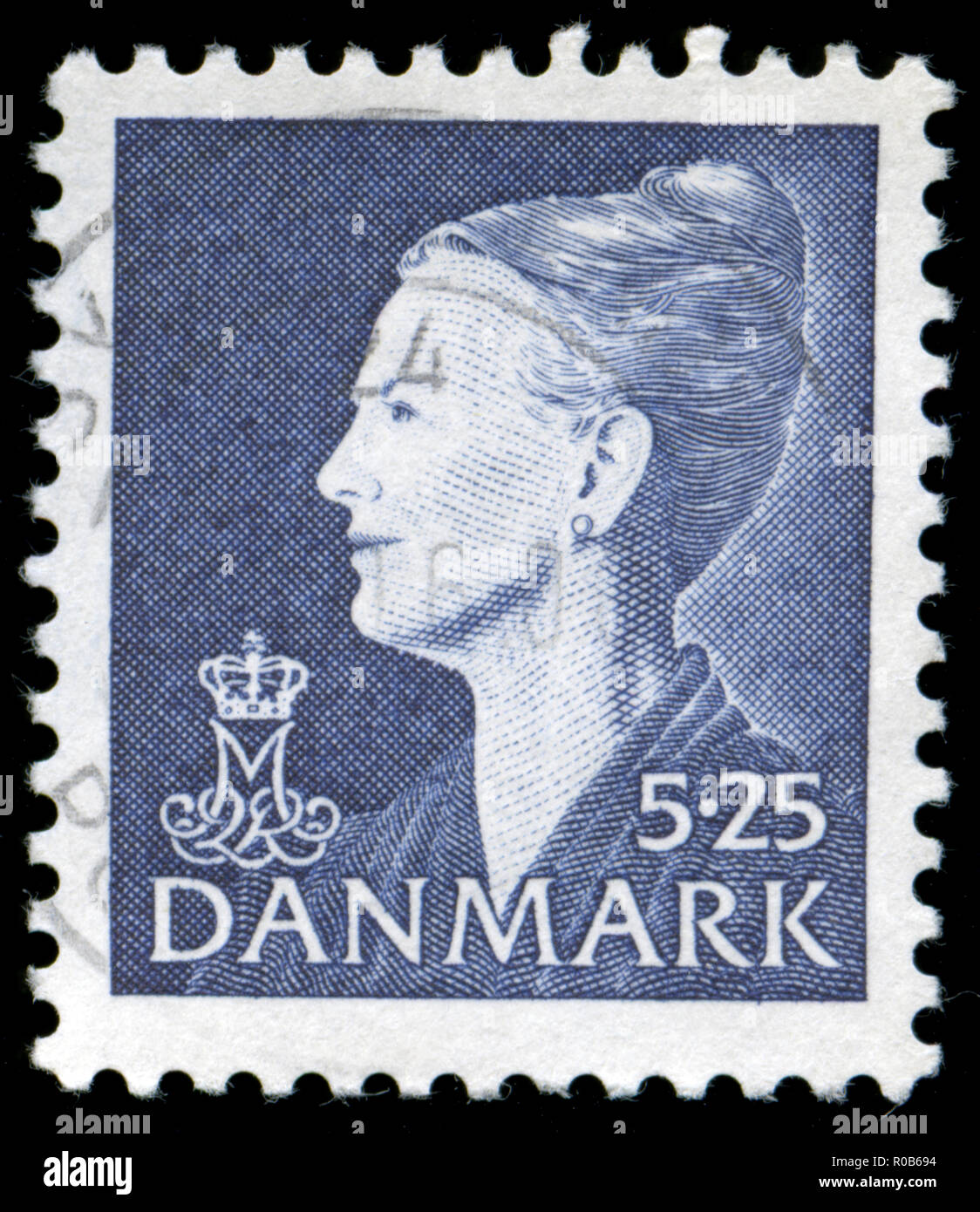 Postmarked stamp from the Denmark in the Queen Margrethe II serie 4 - Stock Image