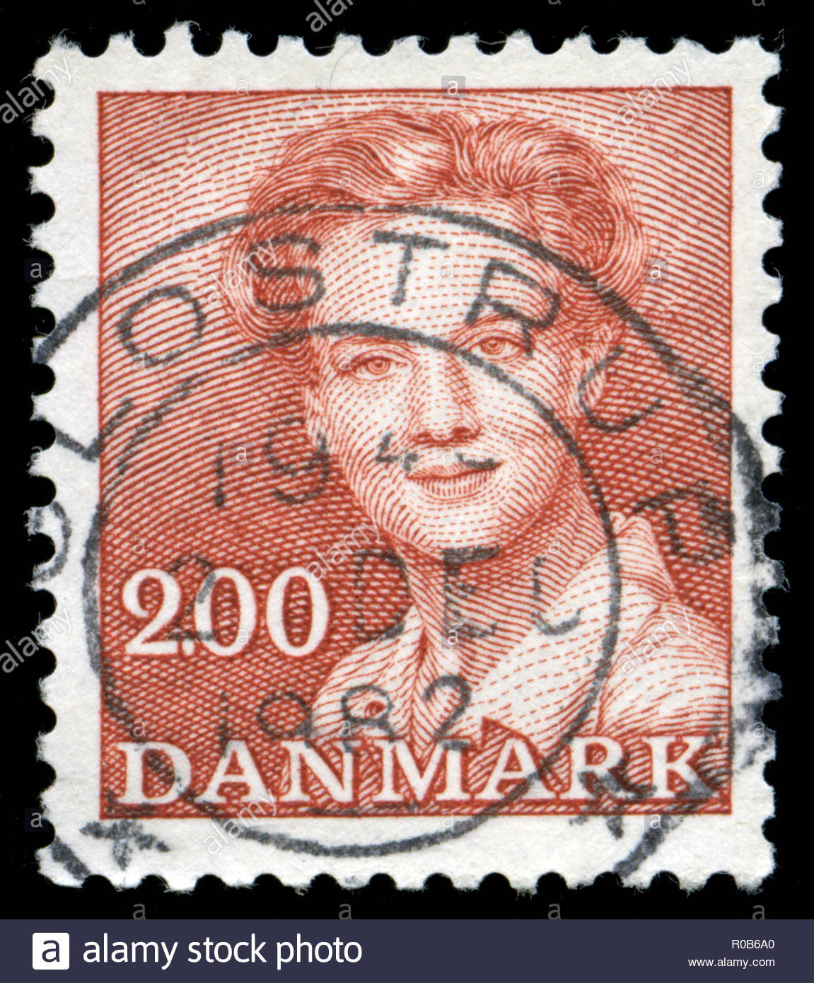 Postmarked stamp from Denmark in the Queen Margrethe II serie 2 - Stock Image