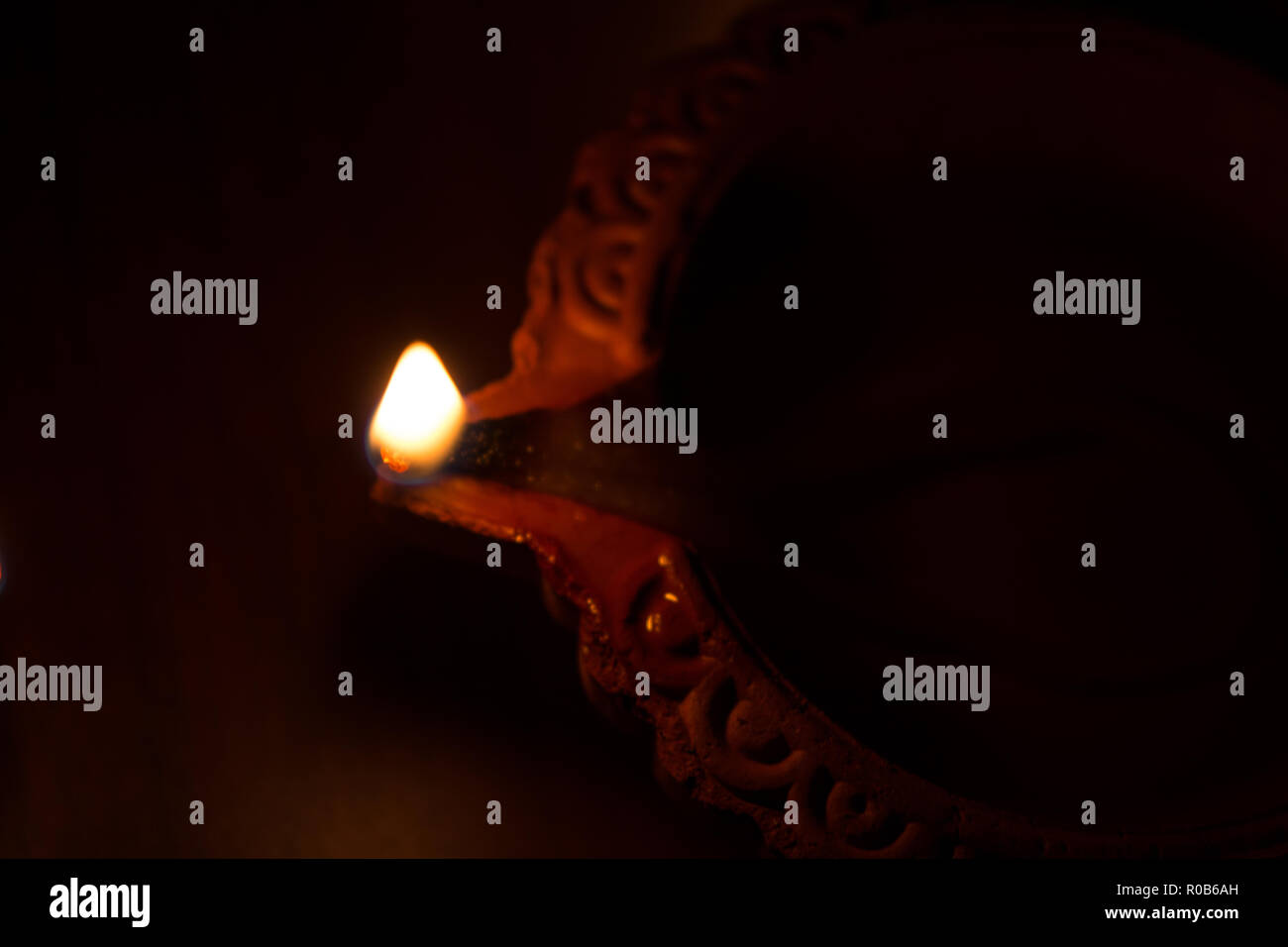 Closeup of Diwali terracotta diyas on dark background which are used lighting up the house during diwali times Stock Photo