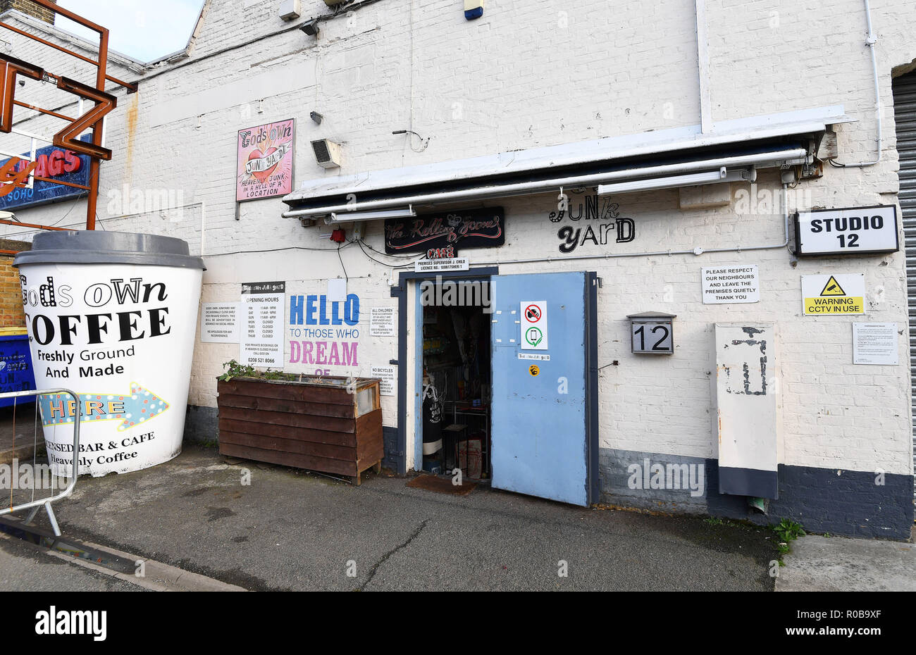 A view of the entrance to God's Own Junkyard in Walthamstow, north east London, which showcases neon signs. - Stock Image