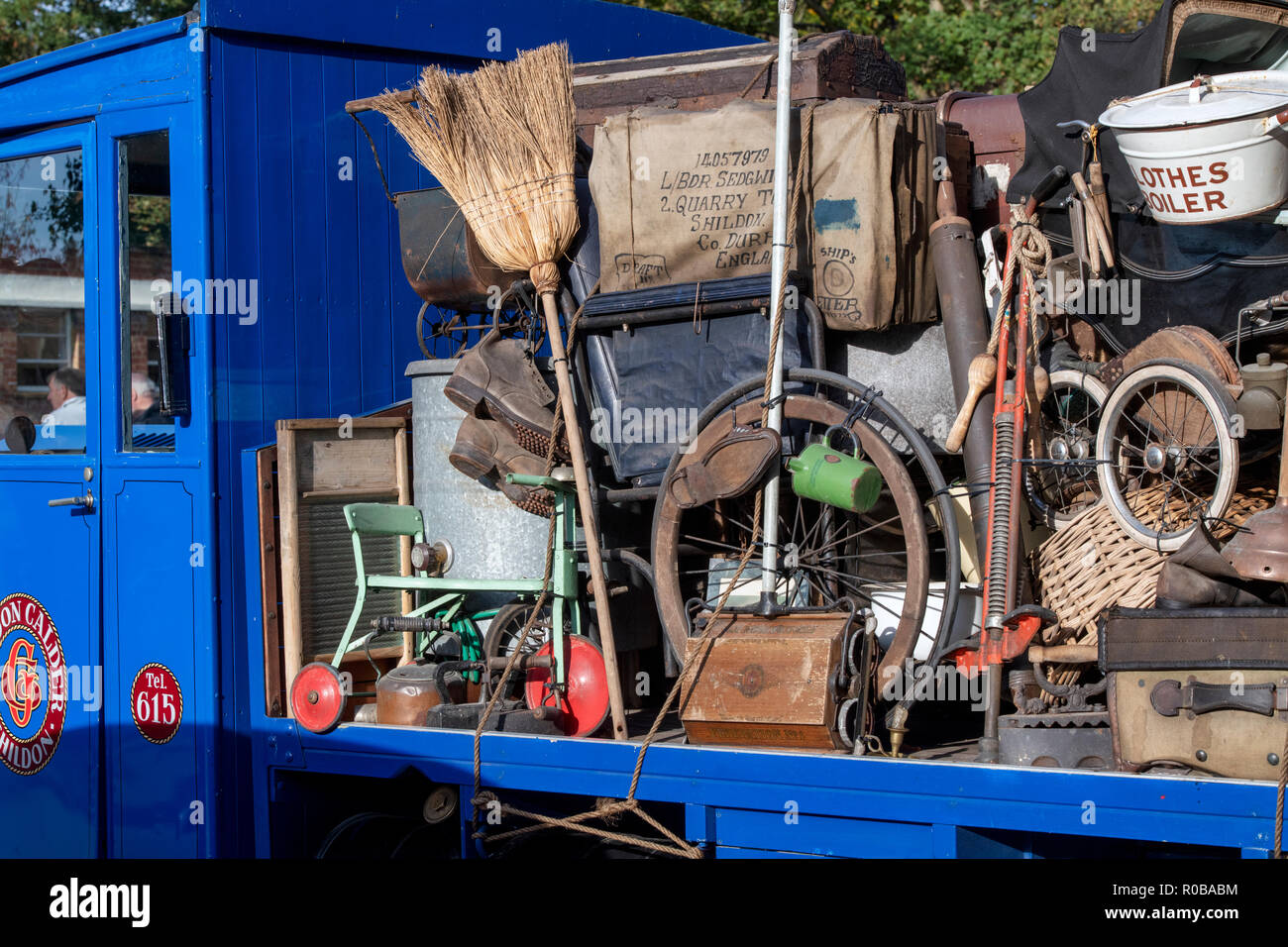 Old vintage household items on the back of a vintage lorry at Bicester heritage centre autumn sunday scramble event. Bicester, Oxfordshire, UK - Stock Image