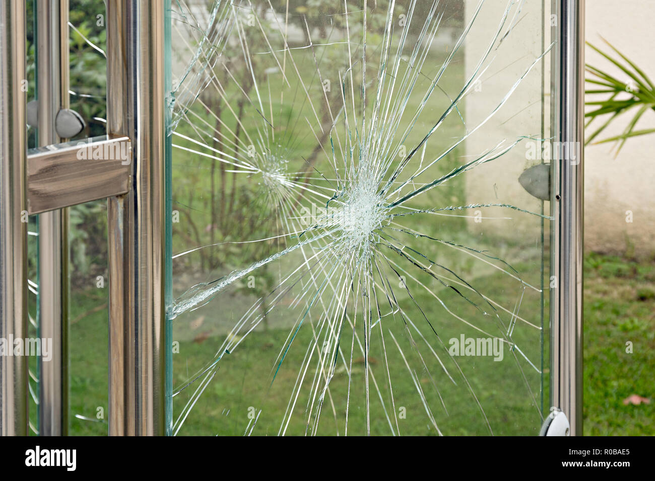 Broken glass of bus stop shelter Vandalism concept - Stock Image