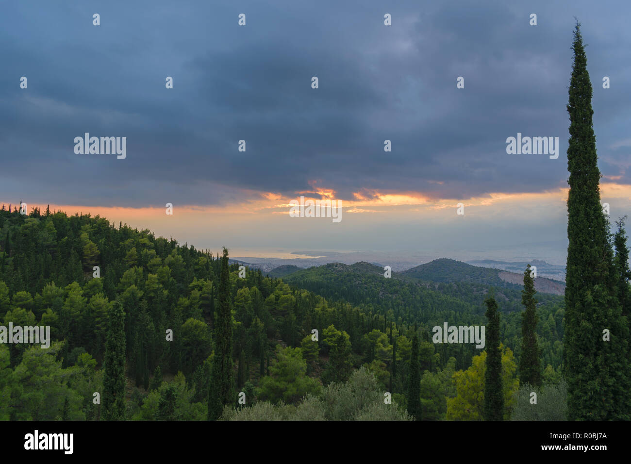 View from mountain Hymettus (Ymittos), Kesariani aesthetic forest on a cloudy day - Stock Image