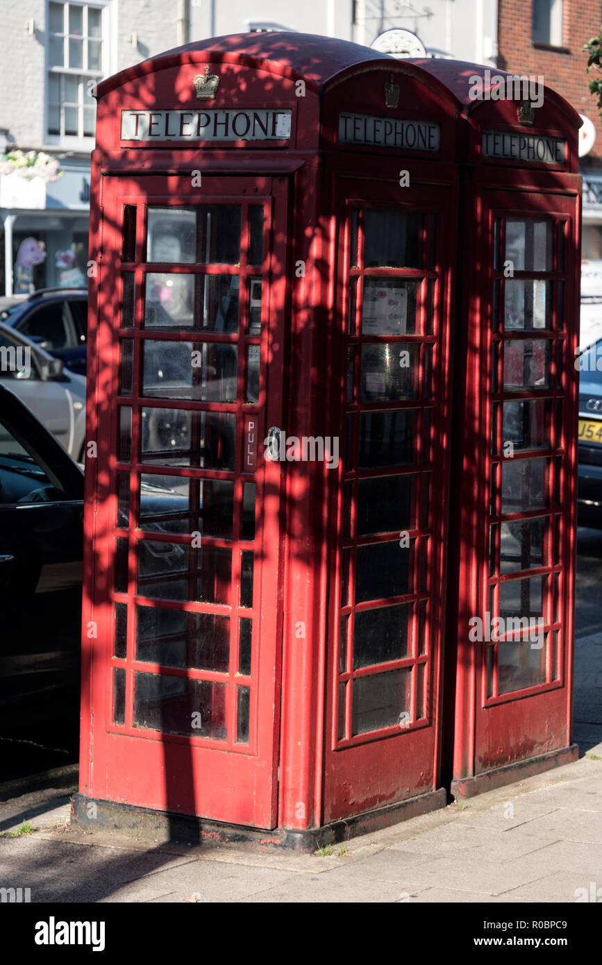 A couple of red telephone kiosks in the High Street at Marlow in Buckinghamshire, Britain - Stock Image