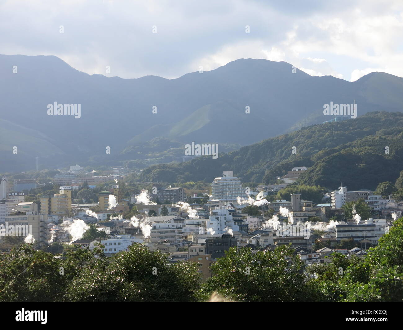View of the city of Beppu where geothermal activity sends plumes of smoke and hot springs at the 'Eight Hells of Beppu'; Japan - Stock Image