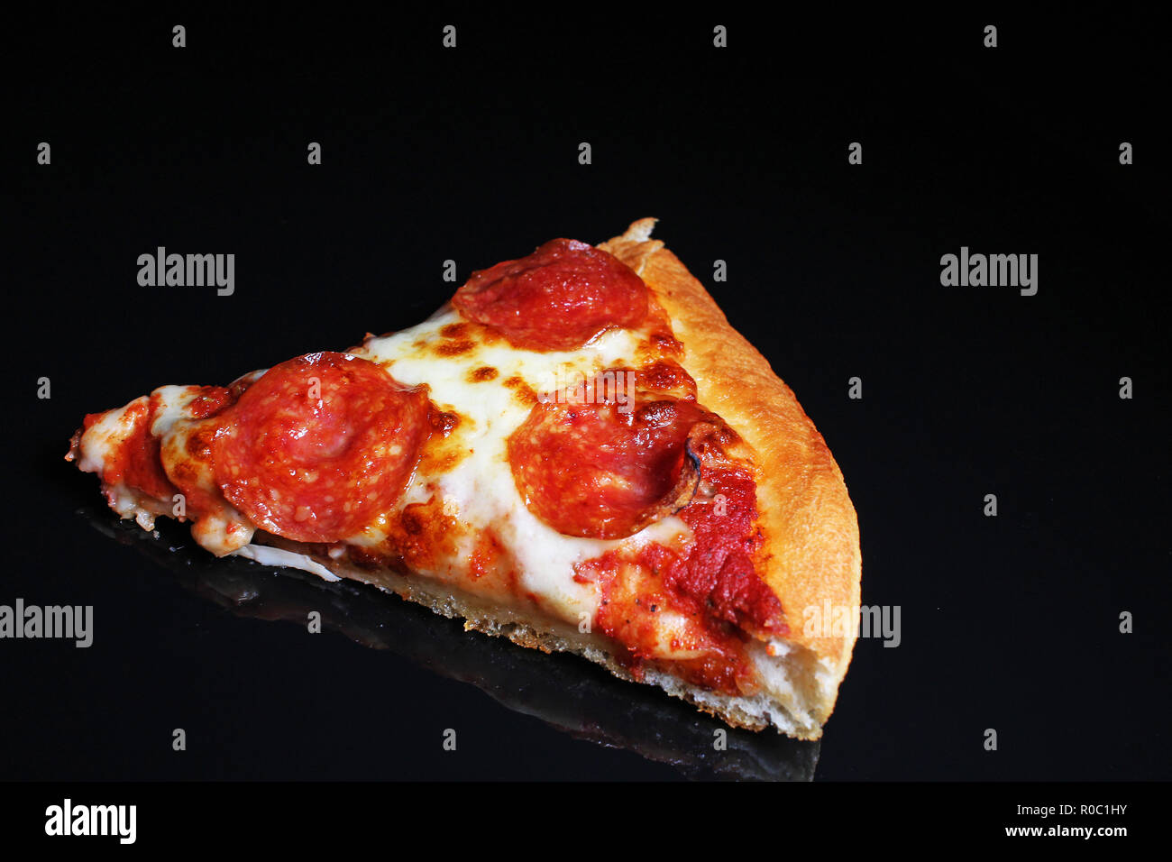 Pizza sausage american salami cheese slice slices pizza delivery - Stock Image