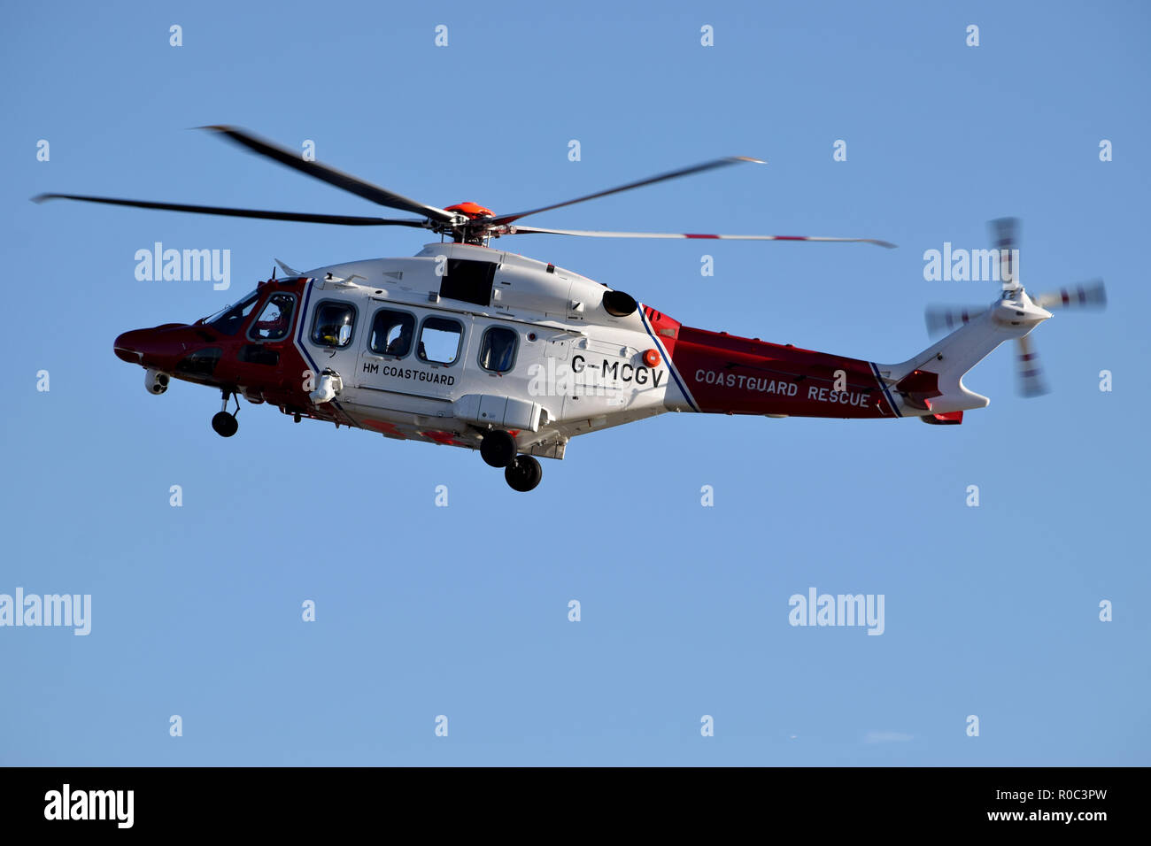 Coastguard rescue helicopter taking part in a search and rescue mission over the river Thames in East London Stock Photo