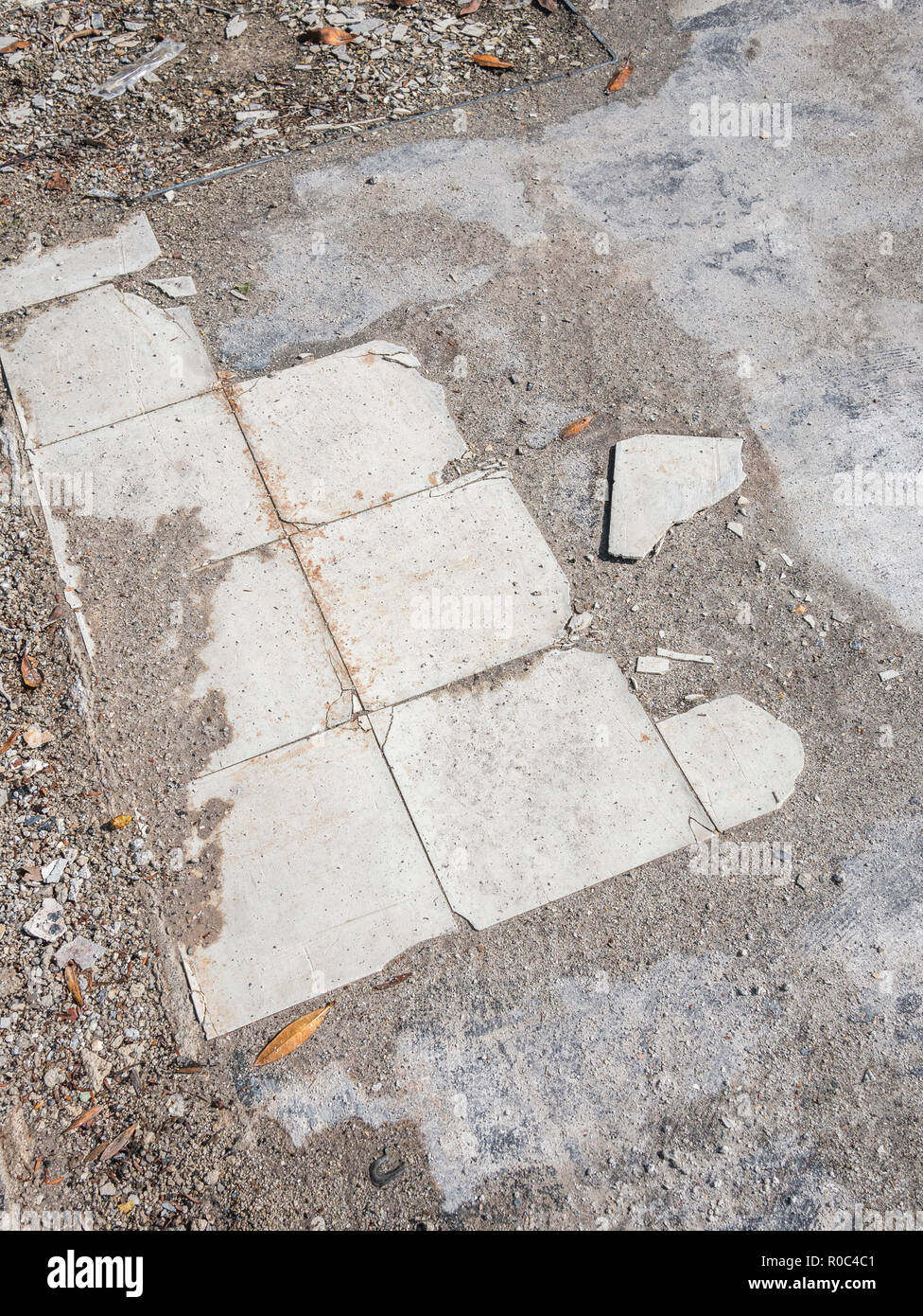 Old kitchen floor tiles in a demolished house. - Stock Image