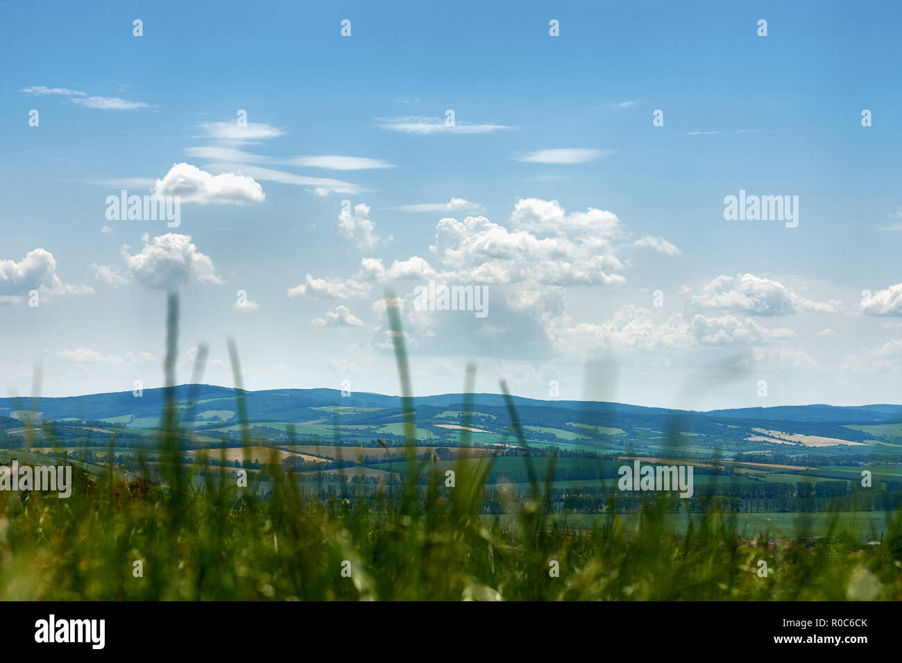 A view of the hillside near Saint Anthony on the farmland around the town of Blatnice in South Moravia. Under a blue sky with clouds - Czech Republic Stock Photo