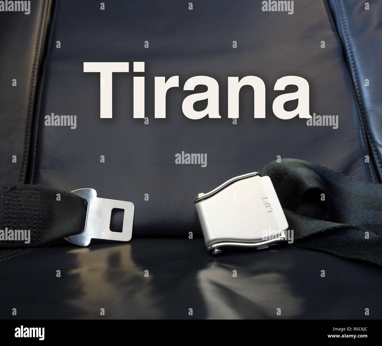 Welcome to Tirana! Let's the journey begin! Airplane comfortable leather seat awaiting passenger for fly, travel, journey, tour, trip, voyage. - Stock Image