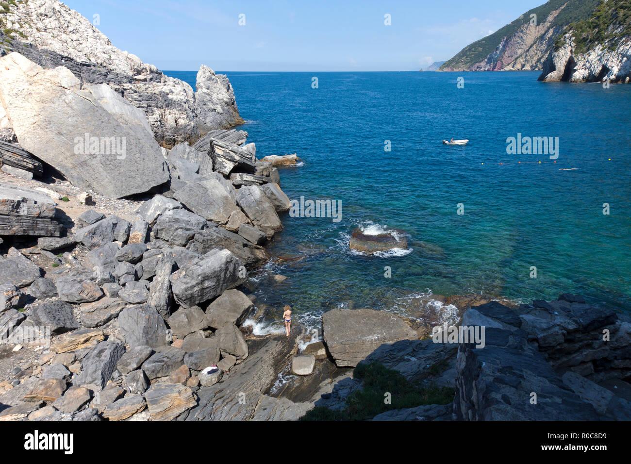 Sunbather, Bay of Poets, Rocky Coast, Portovenere, La Spezia, Italy. - Stock Image