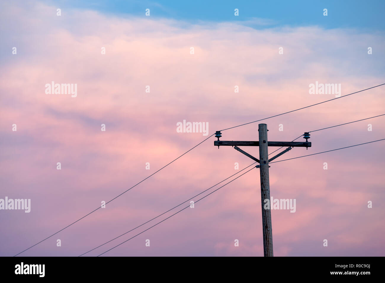 Telegraph pole and wires at sunset - Stock Image