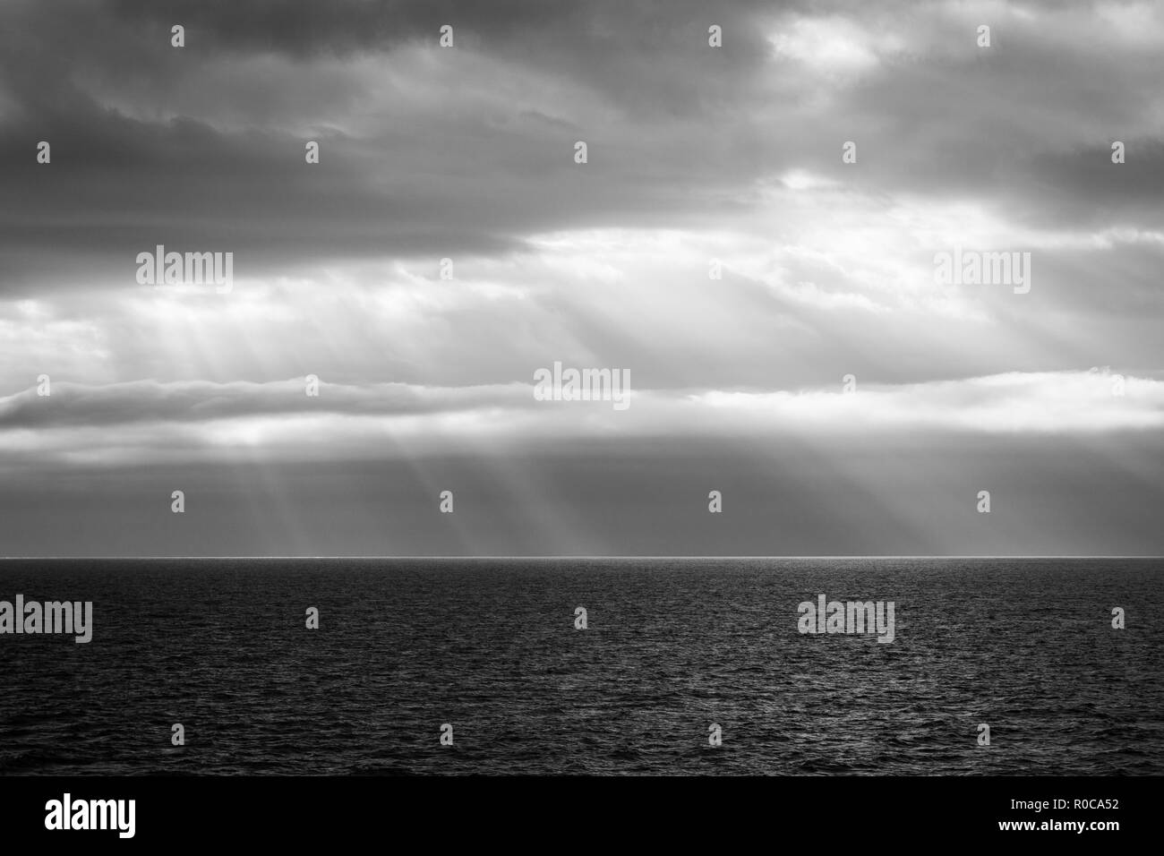 Crepuscular rays (God's hands) over the Gulf of Saint Lawrence as seen from the ferry to the Magdalen Islands. - Stock Image