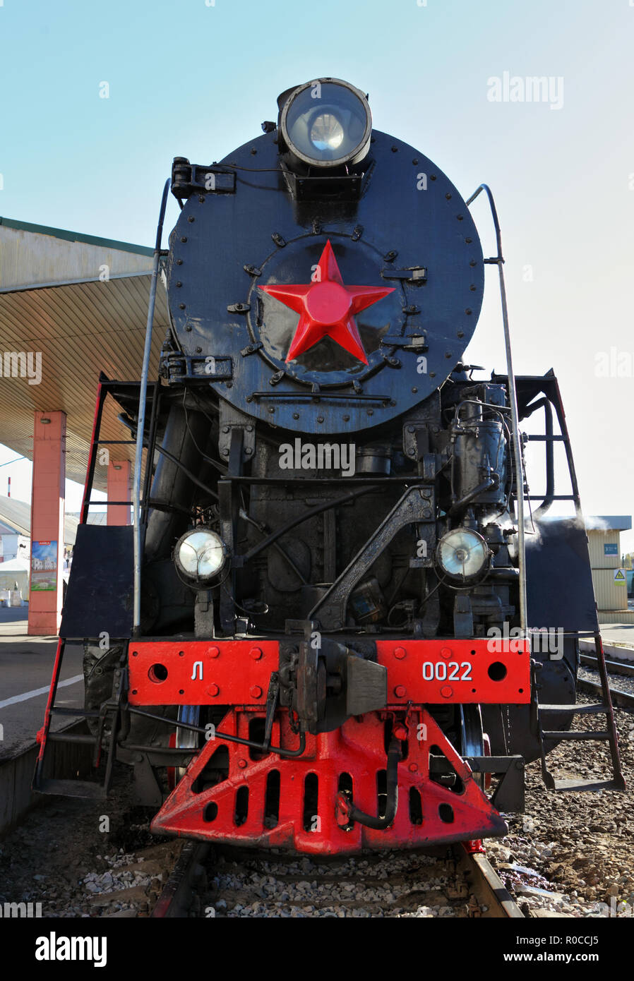 Russian retro steam locomotive series L with symbol of former state the USSR and red wheels. Part of a retro train Stock Photo