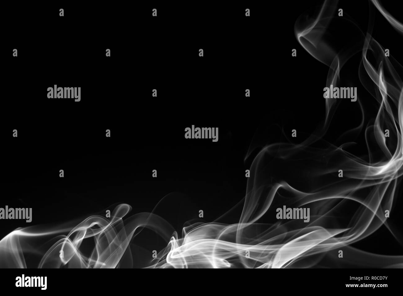 Smoke the white incense on a black background. darkness concept - Stock Image