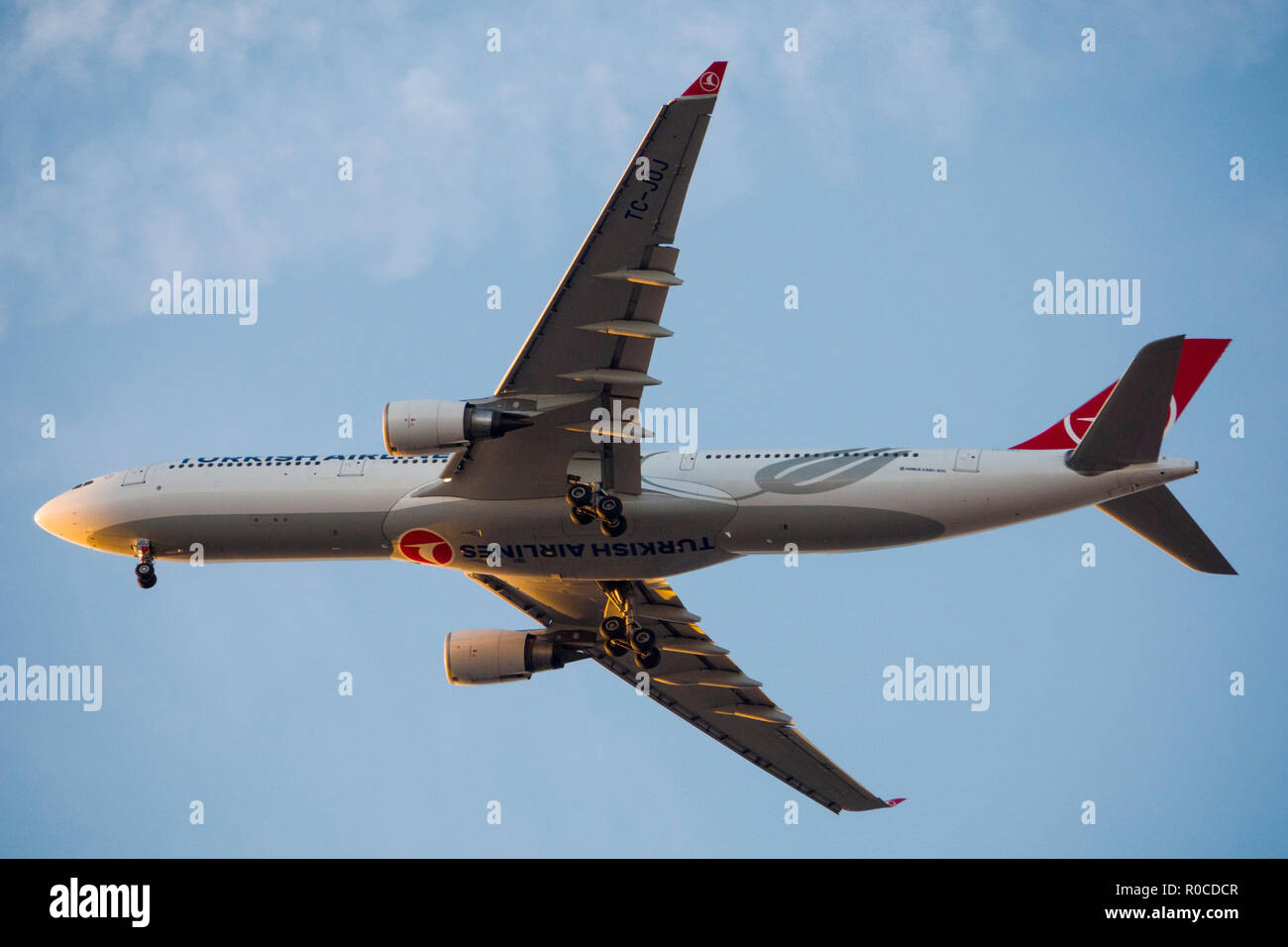 Turkish Airlines Airbus A330-300 aircraft in sky over Istanbul, Turkey - Stock Image