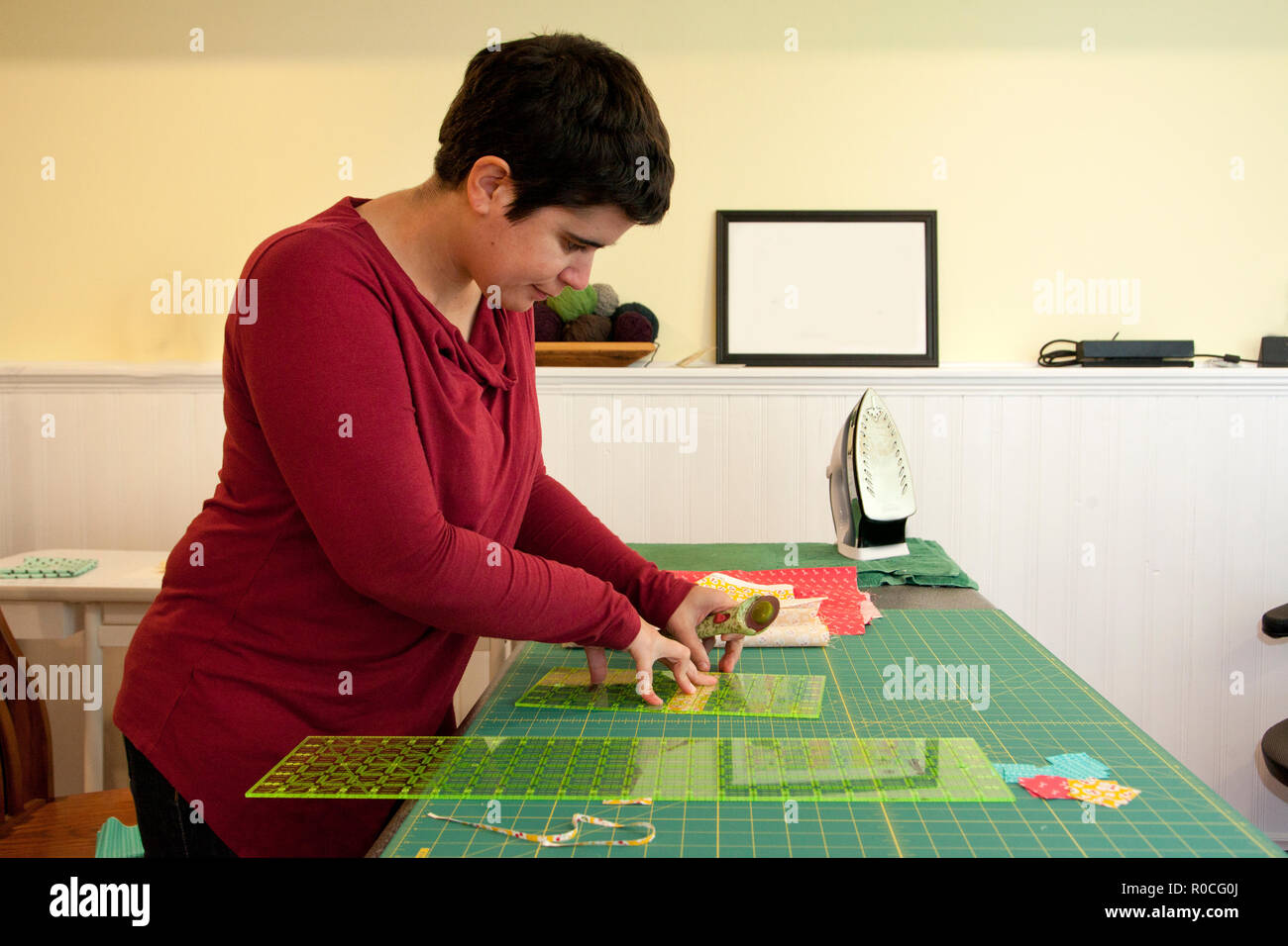 Woman Using A Fabric Cutter And Measuring Tools To Make Small Strips Stock Photo Alamy