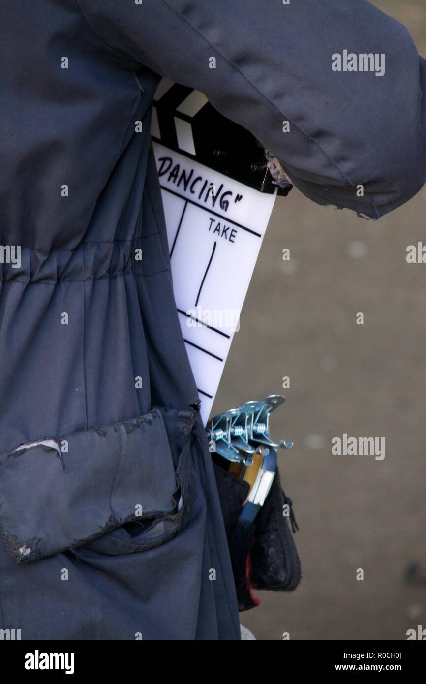 woman holding clapperboard - Stock Image