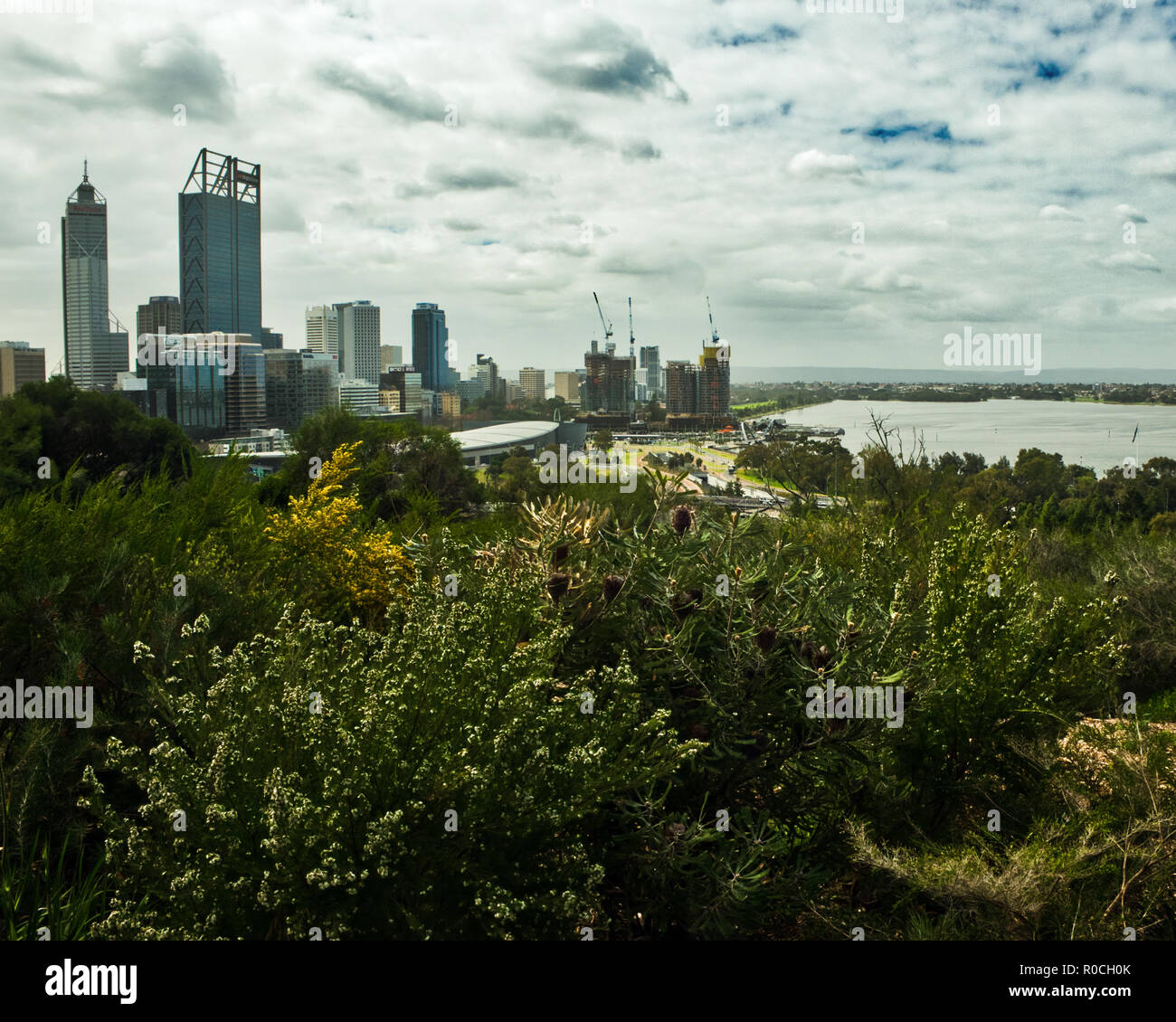 Construction work Perth Skyline by Swan River - Stock Image