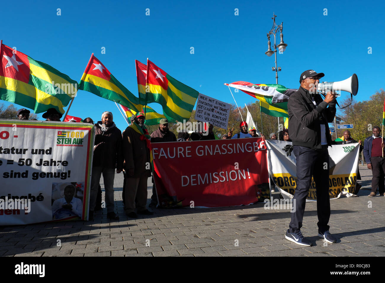 Berlin Germany - Protestors gather to demonstrate against the visit of Faure Gnassingbé the President of Togo - Stock Image