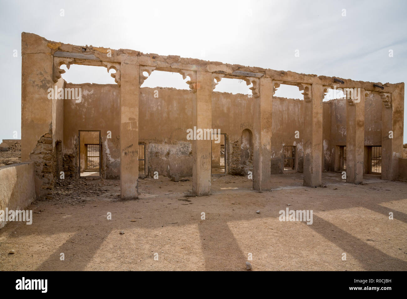Inside the abandoned mosque. Ruined ancient old Arab pearling and fishing town Al Jumail, Qatar. The desert at coast of Persian Gulf. Deserted village - Stock Image