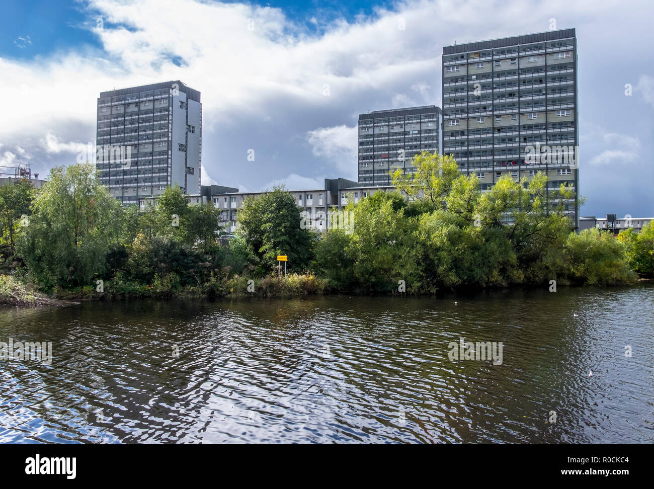 River Clyde Glasgow showing city centre and hi rise flats in the Gorbals - Stock Image