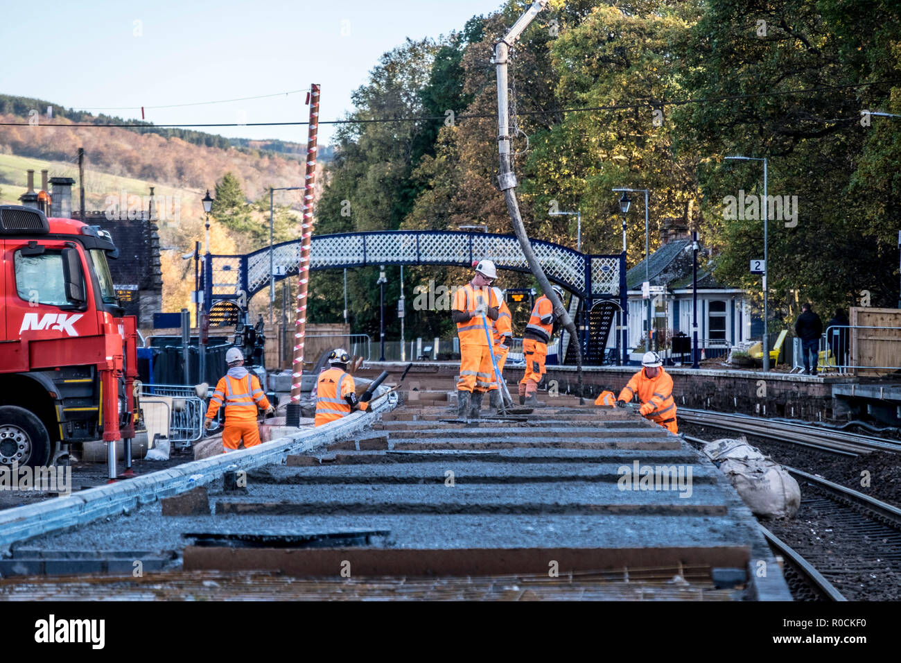 Rail Construction workers building a new platform in station Stock Photo