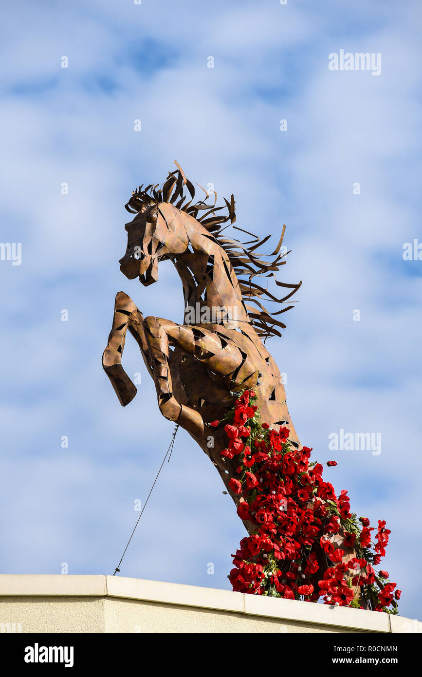 Remembrance Armistice Day centenary commemoration horse with red poppies growing up. Roslin Beach Hotel First World War, Great War memorial display - Stock Image