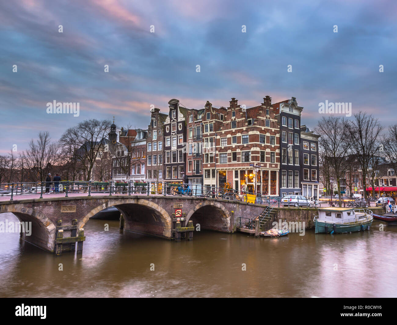 Colorful traditional canal houses on the corner of brouwersgracht and Prinsengracht in the UNESCO World Heritage site of Amsterdam - Stock Image