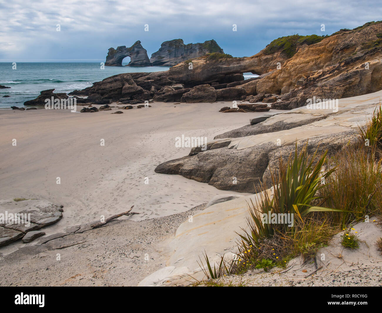 Rock formations on Wharariki Beach, North Island, New Zealand Stock Photo