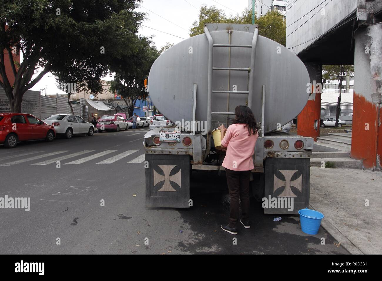 Water distributors supply inhabitants of Mexico City with water in