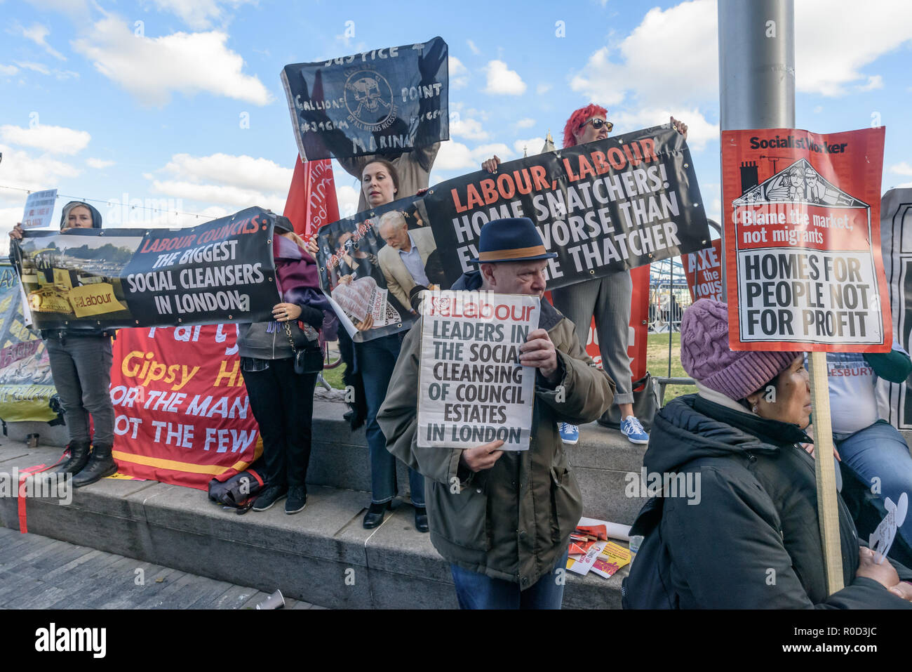 London, UK. 3rd November 2018. Class War supporters came to the 'No Demolitions Without Permission' housing protest at City Hall with banners declaring that Labour Councils were the biggest social cleansers in London and 'Labour, Labour Home Snatchers! Even Worse Than Maggie Thatcher', pointing out that it was largely Labour councils who were demolishing council estates so that developers could replace council houses with large numbers of properties sold at high market prices and a miserably small number of homes at social rent, promoting schemes which cut by thousands the number of council ho Stock Photo