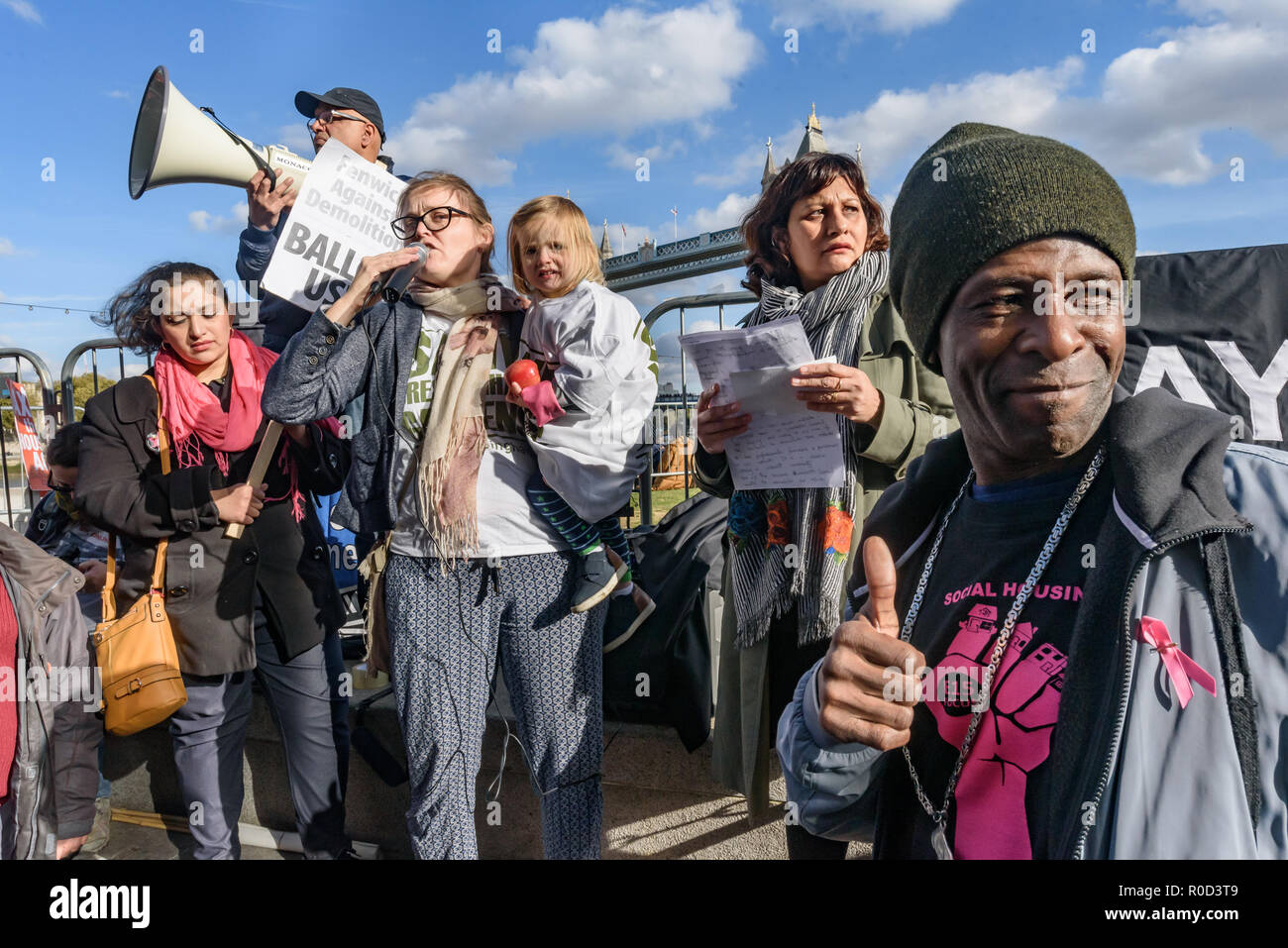 London, UK. 3rd November 2018. A woman from Cressingham Gardens speaks about Lambeth council's scheme to demolish a superrb and popular estate for a scheme which will almost entirely be for sale or rent at high market prices. Several hundred people, mainly from London's council estates under threat of demolition by Labour London councils came to a protest outside City Hall called by 'Axe the Housing Act'. The protest called for an end to estate demolitions unless  approved by a ballot of all residents, and for public land to be used to build more council homes rather than being turned over to  - Stock Image