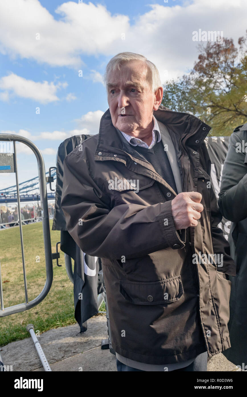 London, UK. 3rd November 2018.Ted Knight, former Lambeth Labour leader, looks around as Class War shout against Labour's record of social cleansing. Several hundred people, mainly from London's council estates under threat of demolition by Labour London councils came to a protest outside City Hall called by 'Axe the Housing Act'. The protest called for an end to estate demolitions unless  approved by a ballot of all residents, and for public land to be used to build more council homes rather than being turned over to developers to make huge profits from high-priced flats. Speaker after speaker - Stock Image