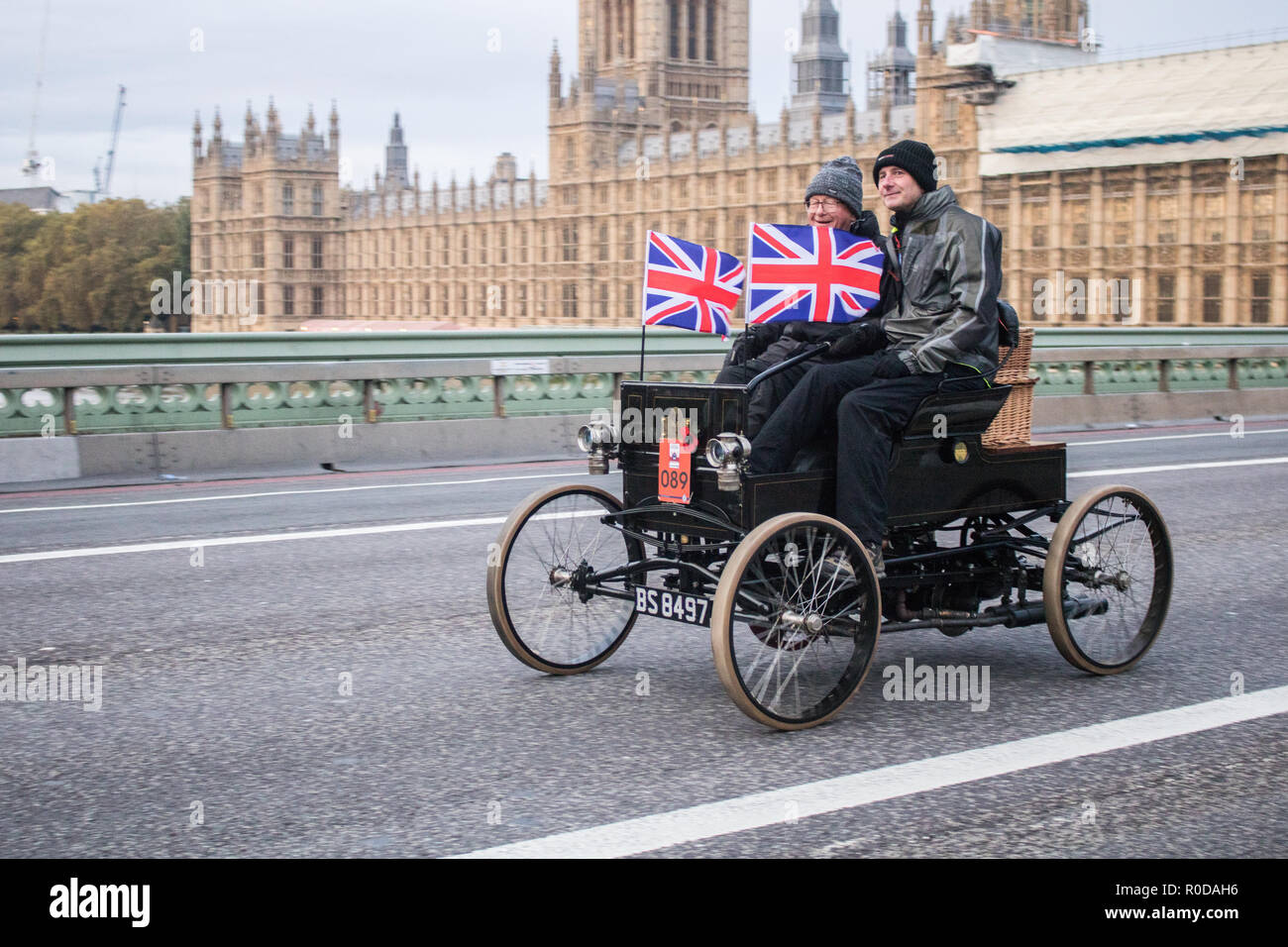 London UK. 4th November 2018 . Participants in  Pre 1905 four-wheeled cars  and antique automobiles cross Westminster Bridge  as they take part in the Bonhams London to Brighton 60 mile journey in the Veteran Car Run, the world's longest running motoring event.The Run commemorates the Emancipation Run of 14 November 1896, which celebrated the Locomotives on the Highway Act, when the speed limit for 'light locomotives' was raised from 4 mph to 14 mph, abolishing the need for vehicles to be preceded by a man on foot Credit: amer ghazzal/Alamy Live News - Stock Image