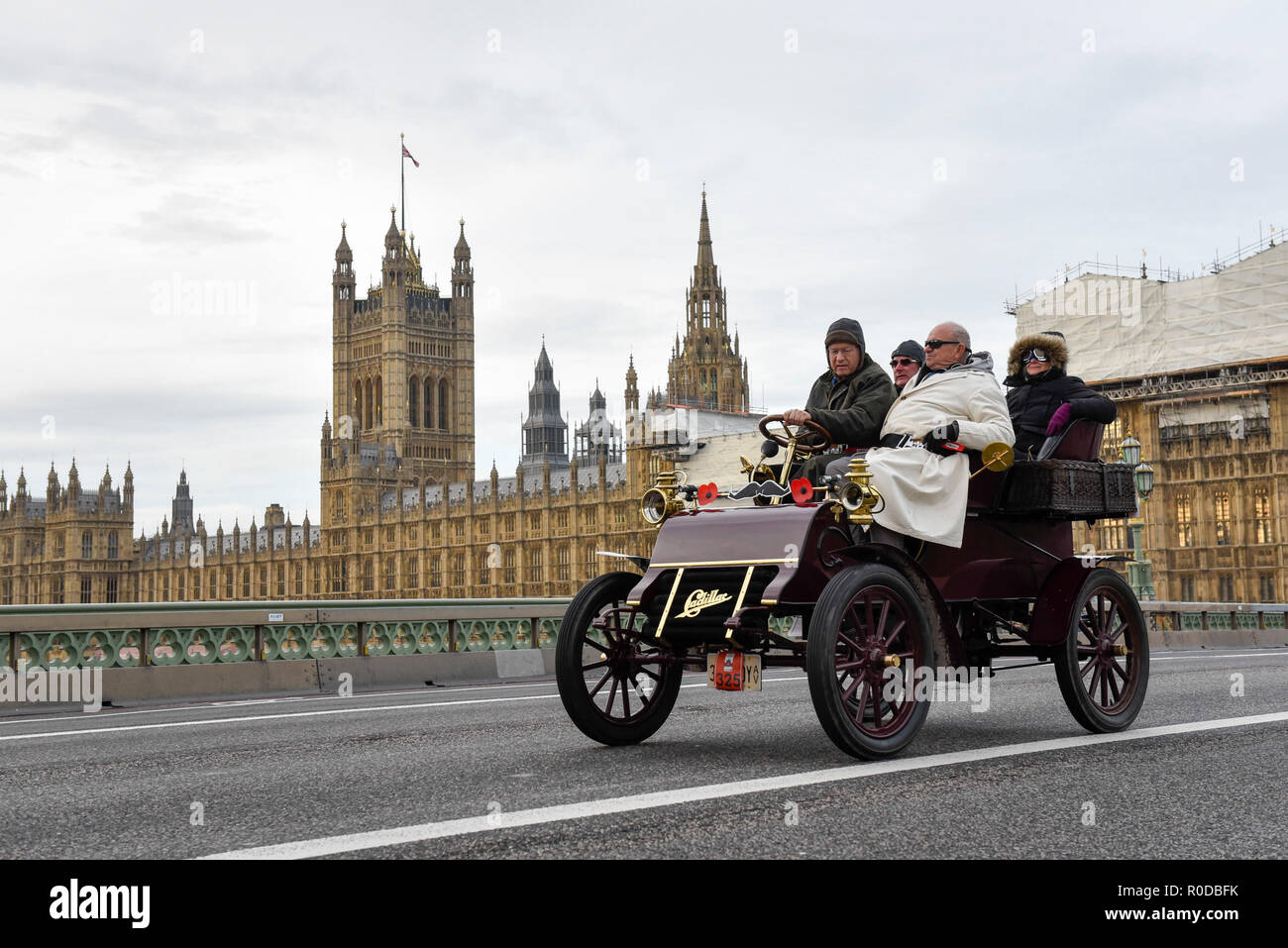 London, UK.  4 November 2018.  Participants cross Westminster Bridge en route to the coast in the 122nd Bonhams London to Brighton Veteran Car Run.  The 60 mile journey is undertaken by over 600 pre-1905 manufactured vehicles, some of which suffer frequent breakdowns.  The Run commemorates the Emancipation Run of 14 November 1896, which celebrated the Locomotives on the Highway Act, when the speed limit for 'light locomotives' was raised from 4 mph to 14 mph, abolishing the need for vehicles to be preceded by a man on foot.   Credit: Stephen Chung / Alamy Live News Stock Photo