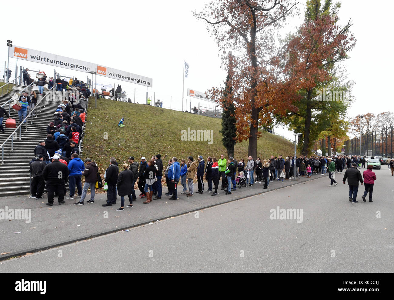 Karlsruhe, Germany. 04th Nov, 2018. Fans of the third-league football team Karlsruher SC are queuing in front of the Wildparkstadion Karlsruhe to dismantle seat shells. Before the demolition work on blocks A1 to A4 begins in the stadium on 05.11.2018, KSC fans can secure up to ten seat shells for five euros each. According to the association, the proceeds from the fan campaign will be donated to the youngsters of Karlsruher SC. Credit: Uli Deck/dpa/Alamy Live News - Stock Image