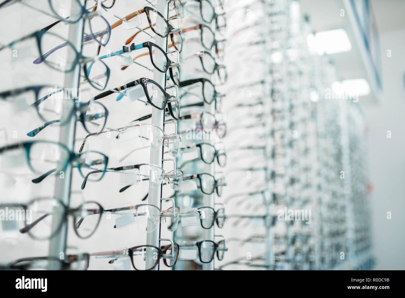 b89c6d9da02 Eyeglasses and sunglasses showcase in optic shop