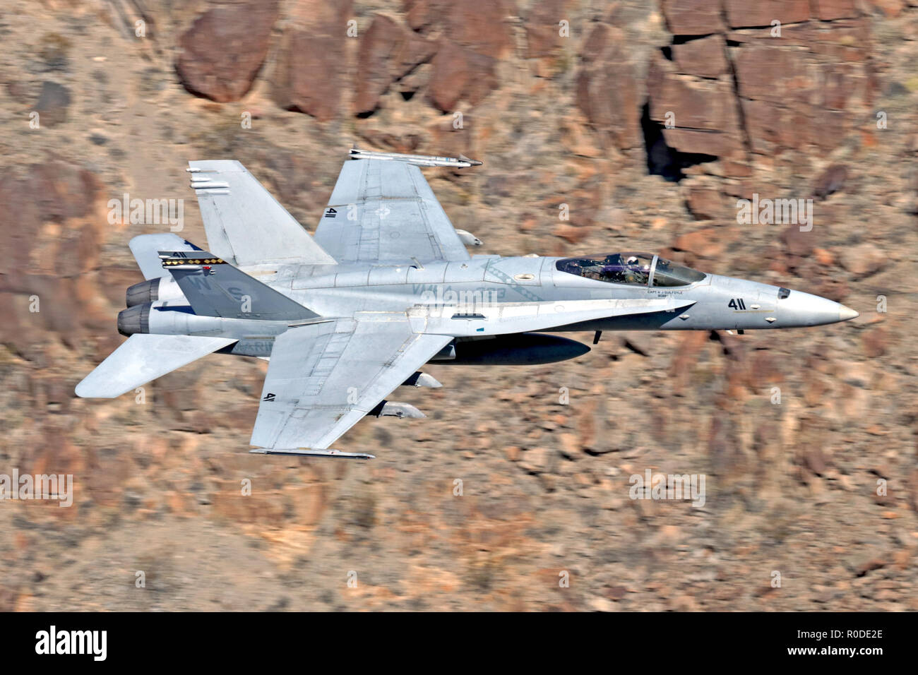 Boeing F/A-18C Hornet flown by US Marines squadron VMFA-323 'Death Rattlers' from Miramar MCAS Flying through Death Valley during 2018 - Stock Image