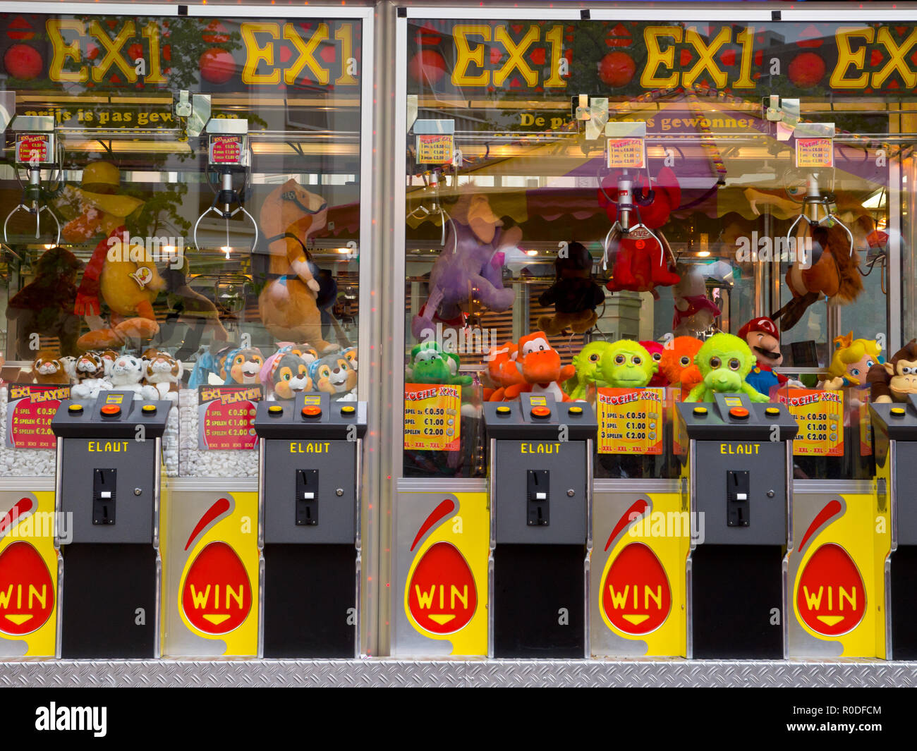 Arcade crane claw machine on an arcade in The Netherlands, Europe - Stock Image