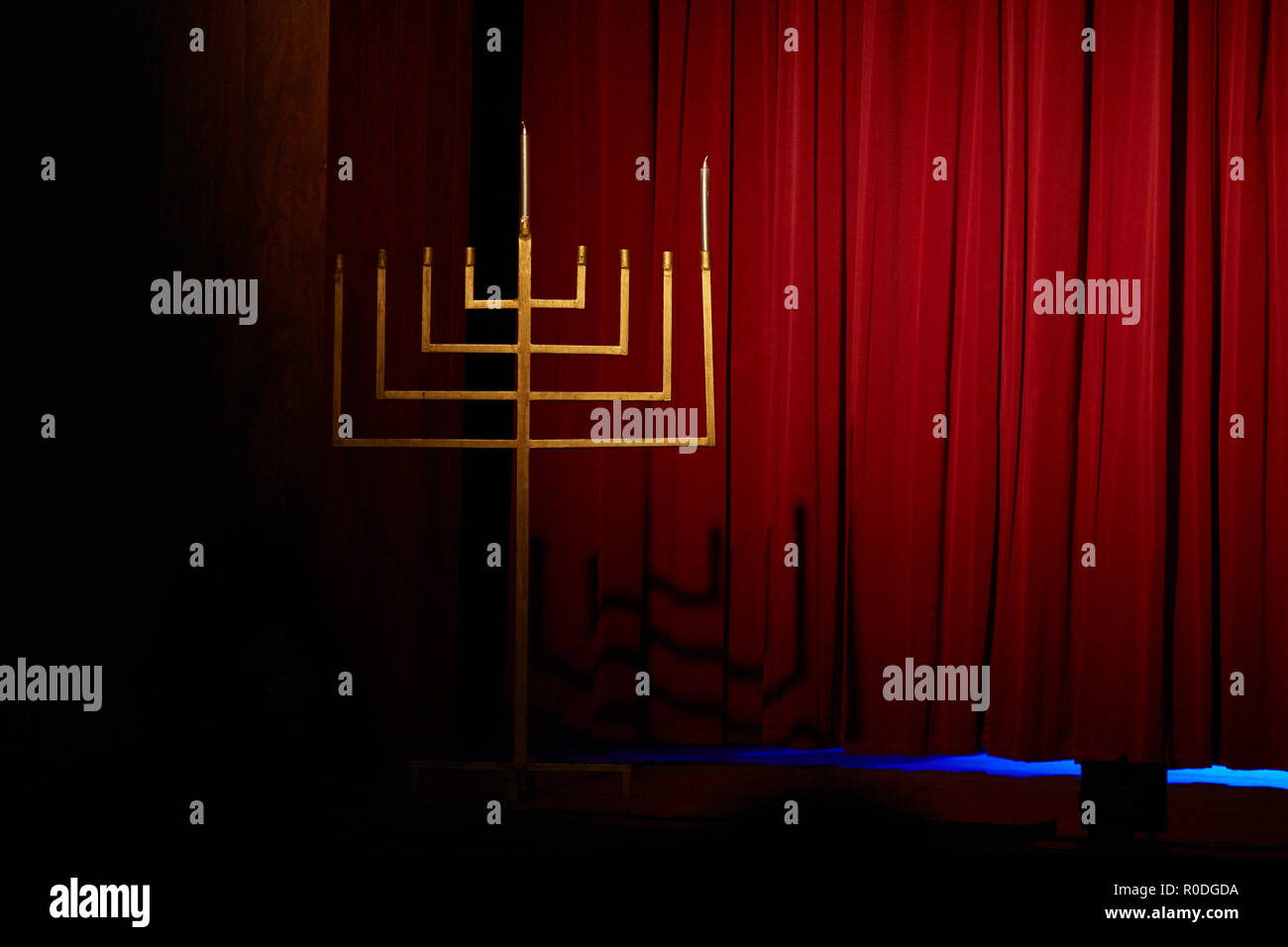 Judaism and jewish faith concept with close up on a menorah with candles for Hanukkah against defocused lights - Stock Image